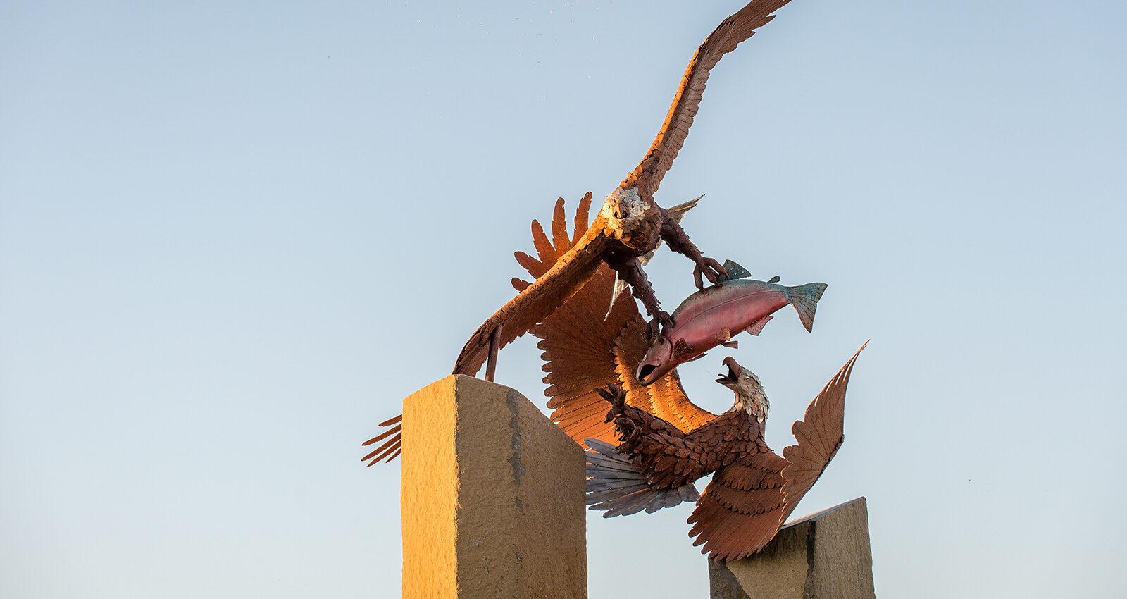 Fair Game artwork's reclaimed-metal eagles and salmon.
