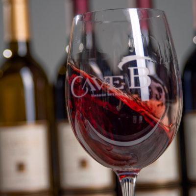 A Cave B red wine swirls in a glass.