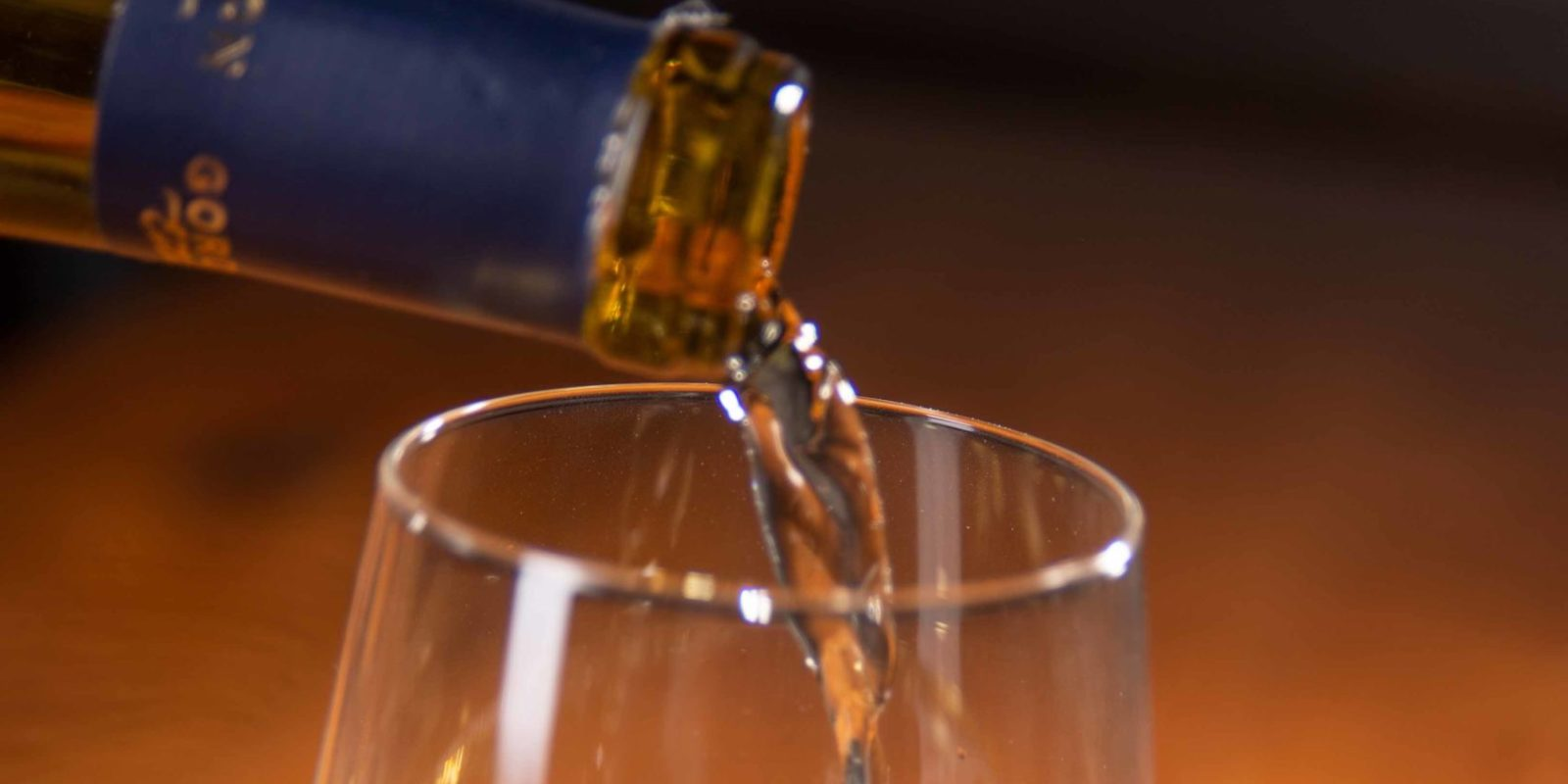 Wine pouring into a glass.
