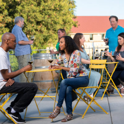 Guests enjoying wine and the weather on a Columbia Gardens' outdoor tasting room patio.