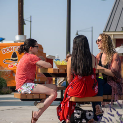 Friends catching up over lunch at Columbia Gardens Food Truck Plaza.