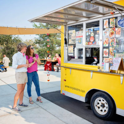 Guest ordering lunch at the Food Truck Plaza.