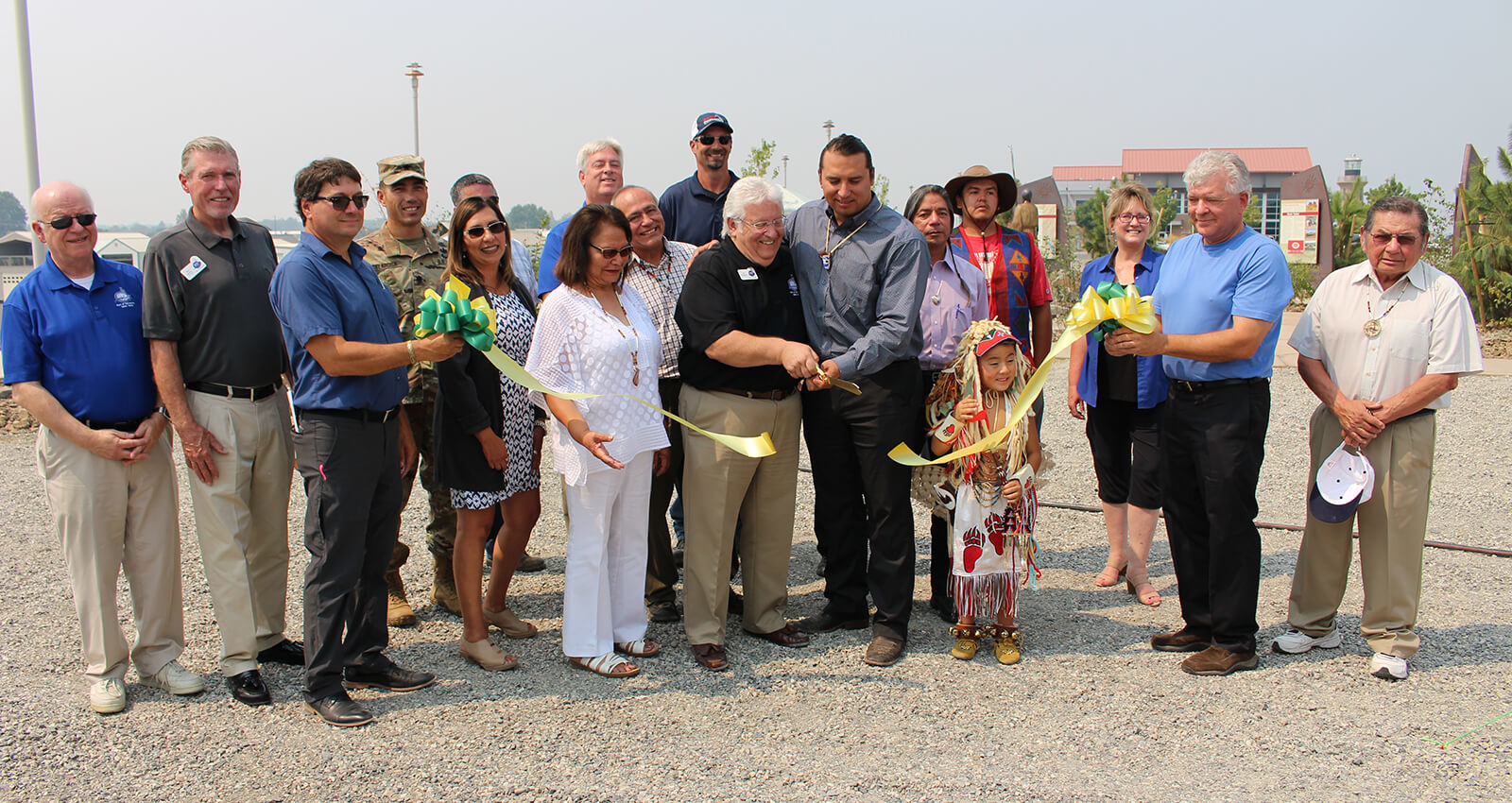 Port and Tribal officials cut ceremonial ribbon celebrating artwork.