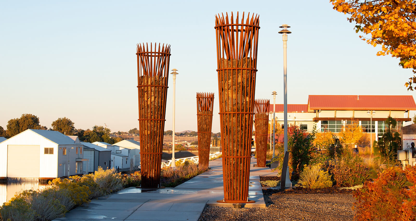 """The Gathering Place Sapáxikas """"Willow Fish Traps"""" structures in fall."""