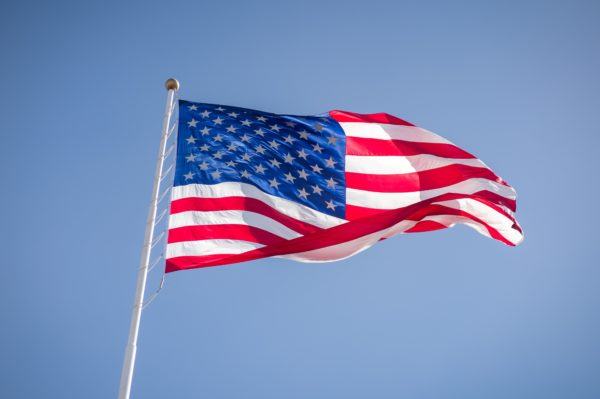 American Flag on flagpole unfurled in the wind